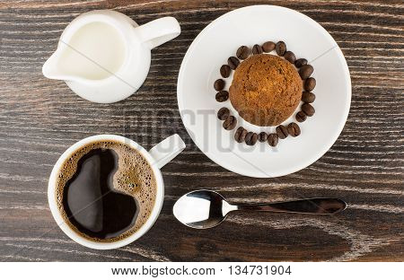 Hot Coffee, Jug Milk And Muffins On Table