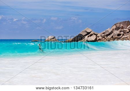 Couple enjoy the blue water of the sea in Seychelles