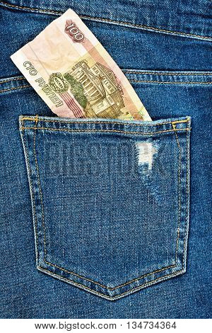 hundred rubles bill in a blue jeans pocket.