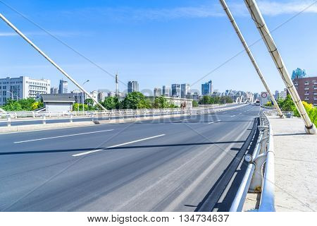 clean road of city under blue sky,tianjin china.