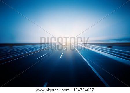 Car driving on sea-crossing bridge,qingdao china,blue toned image.