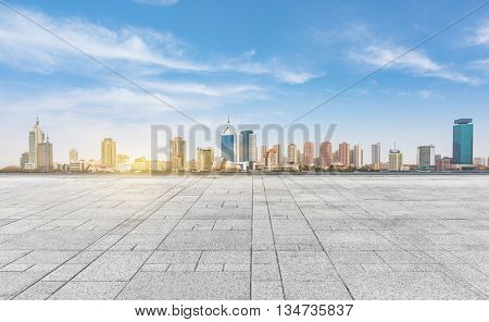 empty tiled floor with city skyline under cloudy sky,chongqing china.