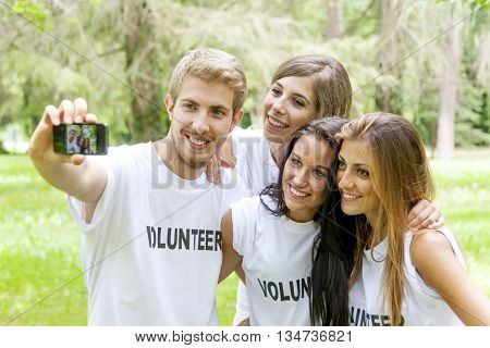 group of teenagers takes a selfie in the park