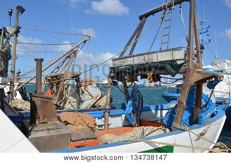 Fishing boats moored in the port of Trapani in Sicily - Italy