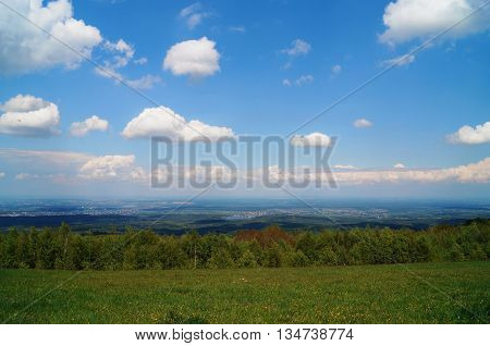 Beautiful panoramic views from the mountain top to the settlement and the sky