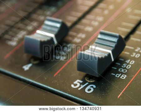 Audio Mixing Console With Faders And Adjusting Knobs