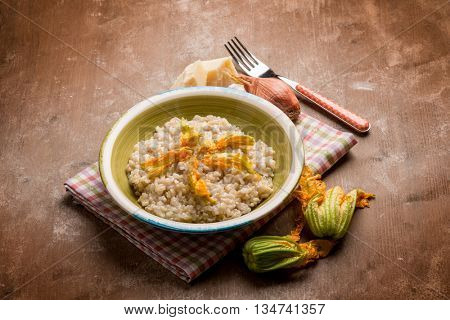 risotto with parmesan cheese and zucchinis flowers
