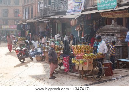 Bhaktapur, Nepal - December 4, 2014: Fruit seller with bicycles in the streets.