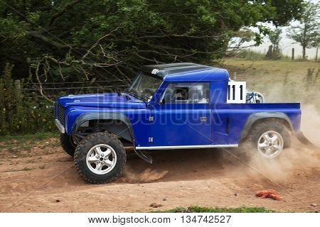 WULSTAN, UK - JULY 21: An unnamed driver exits the final field gate section before heading toward the finish line during the AWDC UK Brit Part Comp Safari competition on July 21, 2013 in Wulstan.