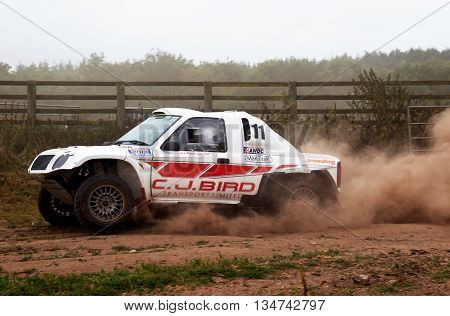 WULSTAN, UK - JULY 21: An unnamed driver negotiates the gated field exit section at speed during the AWDC UK Brit Part Comp Safari competition on July 21, 2013 in Wulstan.