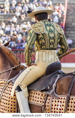 Andujar Spain - September 11 2010: Picador bullfighter lancer whose job it is to weaken bull's neck muscles in the bullring for Jaen Spain