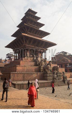 Bhaktapur, Nepal - December 4, 2014: People in front of Nyatapola Pagoda on Taumadhi Square.
