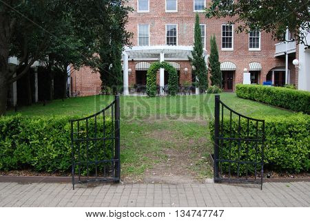 Garden gate leading to outdoor dining patio.