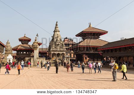 Bhaktapur, Nepal - December 4, 2014: People walking on the Durbar Square.