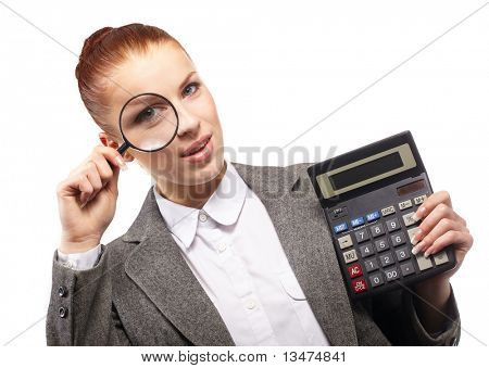 portrait of young businesswoman with calculator and magnifying glass