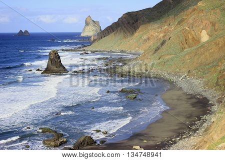 Beautiful landscape with view of Atlantic ocean and beach with black sand in Tenerife