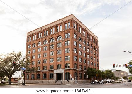 DALLAS TX USA - APR 8 2016: The Sixth Floor Museum at Dealey Plaza. The museum presents the life death and legacy of President John F. Kennedy.