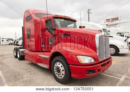 DALLAS USA - APR 9: New Kenworth T680 high-roof sleeper semitrailer truck at the dealership. April 9 2016 in Dallas Texas United States