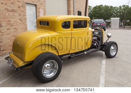 DALLAS USA - APR 9: Yellow hotroad based on the vintage 1932 Ford Coup model. April 9 2016 in Dallas Texas United States