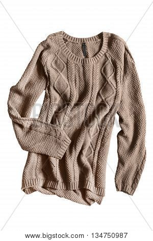 Brown knitted pullover folded on white background
