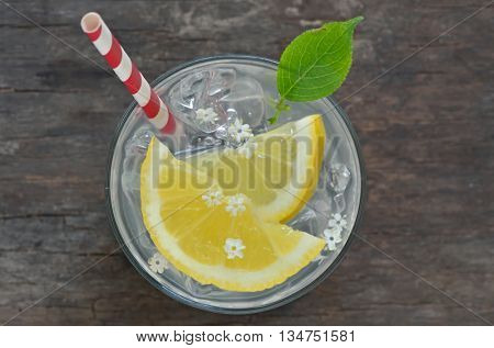 Elder lemonade with ice on old table wood