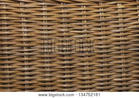 A background of brown rattan texture. Close up