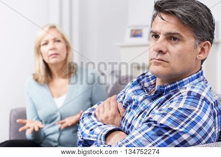Unhappy Mature Couple Having Arguement At Home