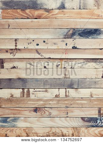 Stack of rough wood strips. Grungy wood texture with paint stains.
