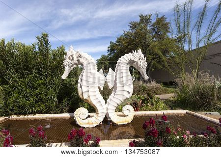 DALLAS USA - APR 8: Sea Horse Statue at the Leonhardt Lagoon of the Fair Park in Dallas. April 8 2016 in Dallas Texas United States