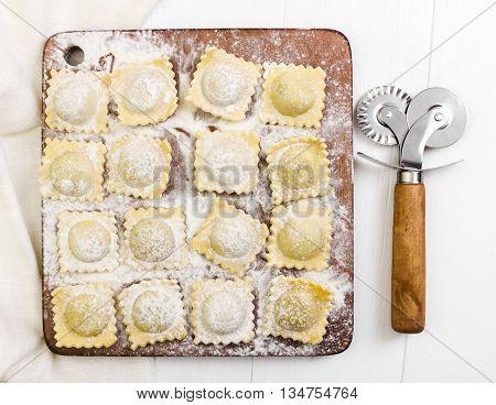 Traditional Italian Ravioli On Cutting Board