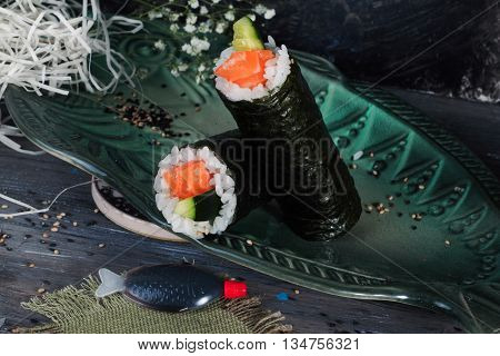 roll with salmon nori style, black background, still life, close up, fast food cucumber