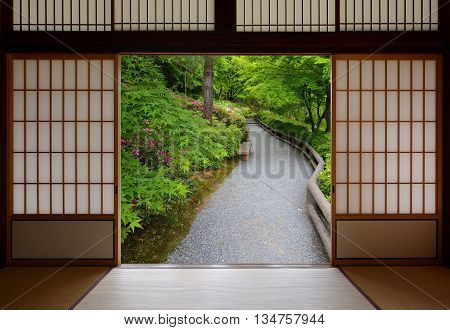 Japanese sliding wood doors opened to a peaceful green nature path