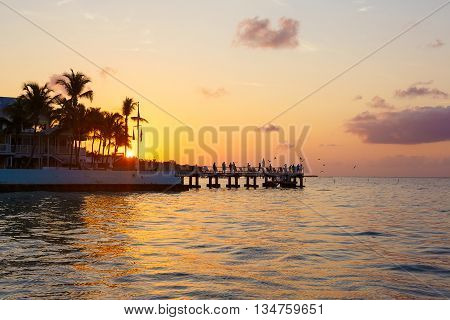 Beautiful sunrise on Key West, Florida, USA. With palms and resorts on background