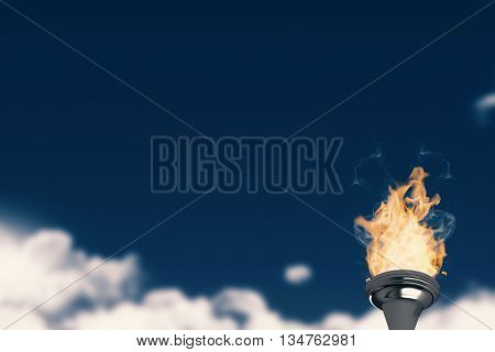 Torch fire against night sky