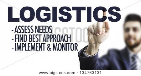 Business man pointing the text: Logistics