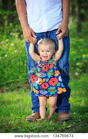 Girl Learning To Walk With Dad