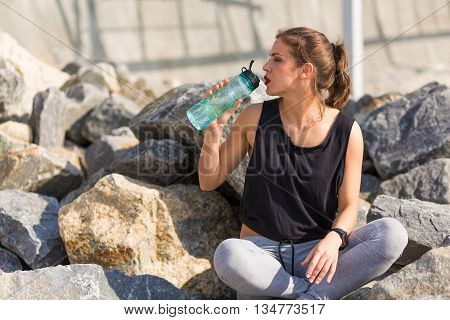 Woman Resting After Training Outside At The Beach