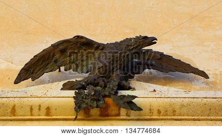 Old Eagle of metal attached to a wall in a country of Lazio in Italy