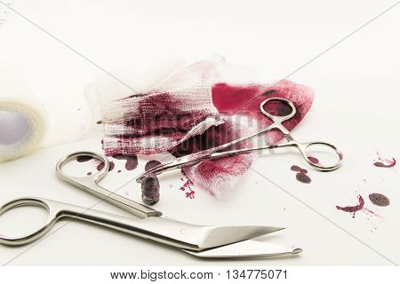Surgical composition with bullet blood and bandage.