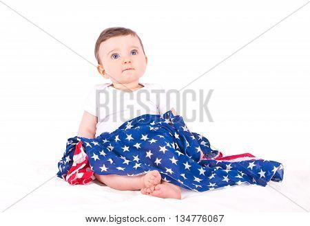 Baby girl with american flag on white background.