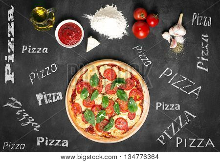 Ingredients of pizza on the chalkboard (tomatoes cheese sauce water spices oil and flour). Prepared pizza. Inscriptions on the board