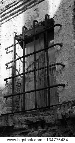 Old railing on a window in a country of Lazio in Italy
