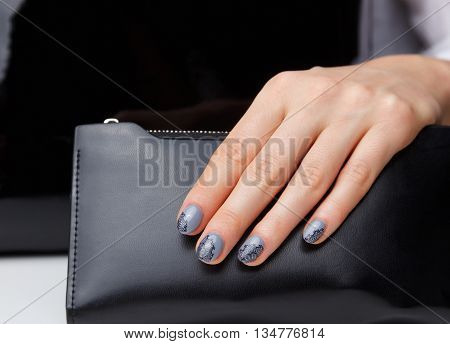 Closeup of elegant painted nails with lace motives