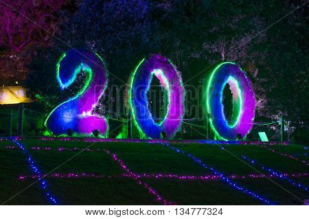 17 JUNE 2016, SYDNEY, AUSTRALIA: Vivid Lights Music Ideas festival. The centennial marker of the Botanic Gardens lit up in Vivid's colours.