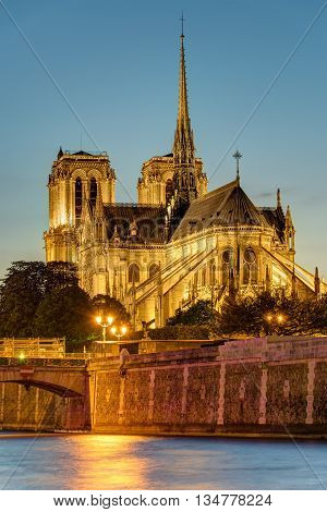 The famous Notre Dame cathedral in Paris after sunset