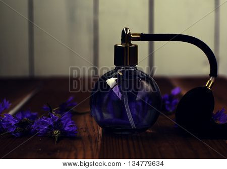 stylish women's perfume bottle with blue flowers