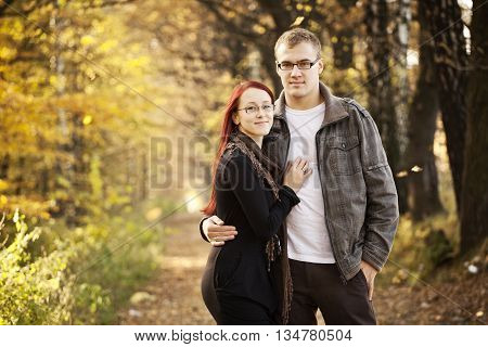 Yound adult couple in a beatiful park during autumn