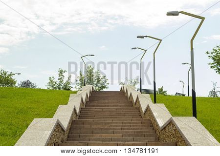 Park stages up on the hill. Walkway with streetlights aside.