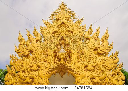 The gold unique architecture at the Wat Rong Khun temple at Chiang Rai, Thailand.
