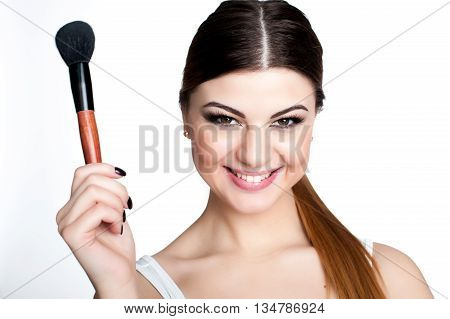Beauty Girl Make Up Artist With Makeup Brush. Bright Holiday Make-up For Brunette Woman With Brown E